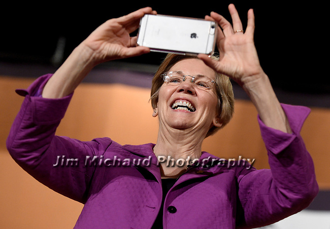 (Farmingham MA 03/24/17) Senator Elizabeth Warren takes a picture of the full house prior to speaking at a town hall meeting, Friday, March 23, 2017, at Farmingham State College. Herald Photo by Jim Michaud