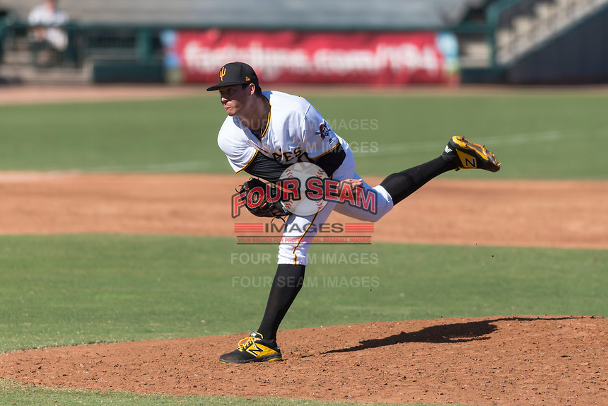 Surprise Saguaros relief pitcher Geoff Hartlieb (70), of the Pittsburgh Pirates organization, follows through on his delivery during an Arizona Fall League game against the Peoria Javelinas at Surprise Stadium on October 17, 2018 in Surprise, Arizona. (Zachary Lucy/Four Seam Images)