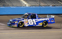 Nov. 13, 2009; Avondale, AZ, USA; NASCAR Camping World Truck Series driver Brett Thompson during the Lucas Oil 150 at Phoenix International Raceway. Mandatory Credit: Mark J. Rebilas-