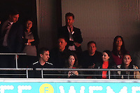 Gary Neville momentarily takes his eye off the football to check his wife's phone during AFC Fylde vs Salford City, Vanarama National League Football Promotion Final at Wembley Stadium on 11th May 2019