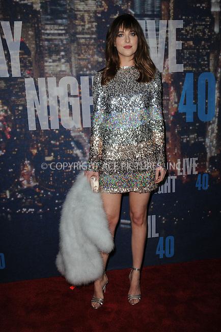 WWW.ACEPIXS.COM<br /> February 15, 2015 New York City<br /> <br /> Dakota Johnson walking the red carpet at the SNL 40th Anniversary Special at 30 Rockefeller Plaza on February 15, 2015 in New York City.<br /> <br /> Please byline: Kristin Callahan/AcePictures<br /> <br /> ACEPIXS.COM<br /> <br /> Tel: (646) 769 0430<br /> e-mail: info@acepixs.com<br /> web: http://www.acepixs.com