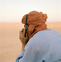 Tuareg Desert Guide using satellite telephone, Sahara Desert, Libya