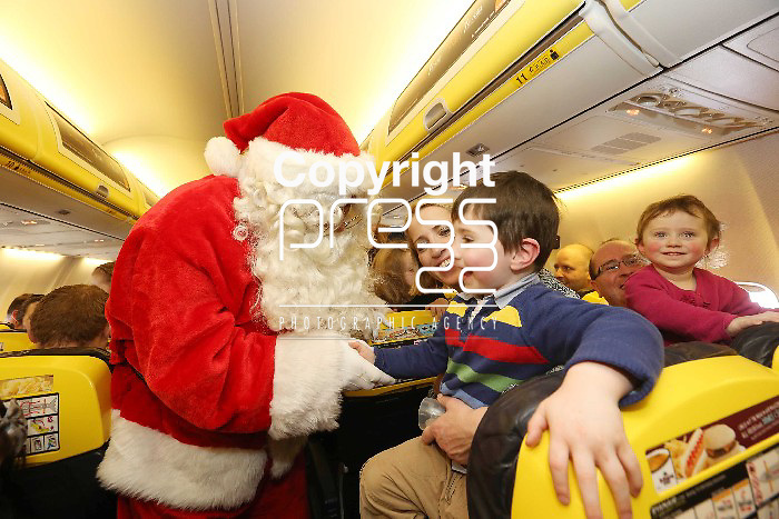 Free Pics   With Compliments Santa meets Jack Quinn age 4 from Tulla , Clare on the 11.40 Ryanair Santa Flight from Shannon Airport to the delight of all the children on board to 40 minute flight on Sunday as Ryanair and Shannon Airport joined forces with Santa and his elves to offer free flights to the young and the young at heart to meet with the man himself as a thank you to the people of the midwest. Pic. Brian Arthur/ Press 22.