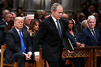 Former President George W. Bush walks past President Donald Trump, first lady Melania Trump, Michelle Obama and former President Bill Clinton to give a eulogy for his father, former President George H.W. Bush during the State Funeral at the National Cathedral, Wednesday, Dec. 5, 2018, in Washington. <br /> Credit: Alex Brandon / Pool via CNP / MediaPunch