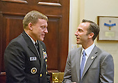 United States Navy Admiral Mike Rogers, Director of the National Security Agency, Commander of the US Cyber Command and Chief of the Central Security Service, left, speaks with Reed Cordish, Director of Government Initiatives, right, prior to the arrival of US President Donald Trump who will hold a listening session with cyber security experts in the in the Roosevelt Room of the White House in Washington, DC on Tuesday, January 31, 2017.  <br /> Credit: Ron Sachs / Pool via CNP