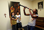 Faith Krone, 11, belts out a tune on her clarinet while practicing in the chapel at The Reality Center in Durham.