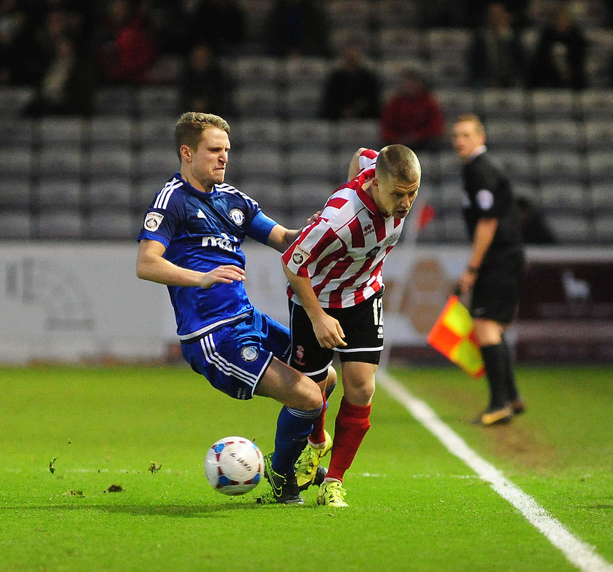 Lincoln City&rsquo;s Terry Hawkridge vies for possession with FC Halifax Town&rsquo;s Nicky Wroe<br /> <br /> Photographer Andrew Vaughan/CameraSport<br /> <br /> Football - Vanarama National League - Lincoln City v FC Halifax Town - Saturday 26th December 2015 - Sincil Bank - Lincoln<br /> <br /> &copy; CameraSport - 43 Linden Ave. Countesthorpe. Leicester. England. LE8 5PG - Tel: +44 (0) 116 277 4147 - admin@camerasport.com - www.camerasport.com