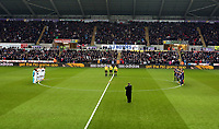 Saturday 19 January 2013<br /> Pictured: Both teams observe a minute's applause in tribute to the recent passing of former Swansea player Jeff Thomas.<br /> Re: Barclay's Premier League, Swansea City FC v Stoke City at the Liberty Stadium, south Wales.