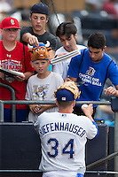 Durham Bulls pitcher CJ Riefenhauser (34) signs autographs for fans prior to the game against the Indianapolis Indians at Durham Bulls Athletic Park on August 4, 2015 in Durham, North Carolina.  The Indians defeated the Bulls 5-1.  (Brian Westerholt/Four Seam Images)