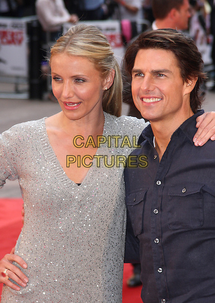 CAMERON DIAZ & TOM CRUISE .The UK Premiere of 'Knight and Day' at the Odeon, Leicester Square, London, England, UK, July 22nd 2010.half length grey gray sequined sequin silver sweater jumper v-neck dress knitted hand on hip arm around blue navy shirt jeans smiling .CAP/JIL.©Jill Mayhew/Capital Pictures