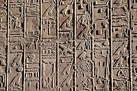 Ancient hieroglyphs on wall at the Temple of Karnak, located at modern day Luxor or ancient Thebes, Egypt