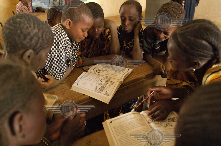 Children in a classroom in the village of Intedeyne. Children's education remains a major challenge for Mali, which has the highest percentage of people living below the poverty line of any country in the world, with female literacy rates 50 percent lower than that of men...
