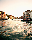 ITALY, Venice, people traveling on water taxi with buildings in the background