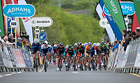 Picture by Allan McKenzie/SWpix.com - 15/05/2018 - Cycling - OVO Energy Tour Series Mens Race Round 2:Motherwell - The peloton climbs the finishing straight, Adnams, Skoda, branding.