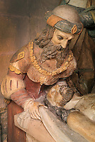 Joseph of Arimathea, who donated his tomb to Jesus after his death, leaning over the dead Christ, from a polychrome sculpture of the Entombment, 16th century, in the Collegiale Notre-Dame de Poissy, a catholic parish church founded c. 1016 by Robert the Pious and rebuilt 1130-60 in late Romanesque and early Gothic styles, in Poissy, Yvelines, France. In the group, Christ's body is surrounded by the Virgin, St John the Baptist, Joseph of Arimathea, Mary Magdalene, the holy women and Nicodemus at the foot of the tomb. The Collegiate Church of Our Lady of Poissy was listed as a Historic Monument in 1840. Picture by Manuel Cohen