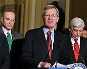Washington, DC - December 24, 2009 -- United States Senator Max Baucus (Democrat of Montana) makes remarks after voting to pass H.R. 3590, regarding health care reform in the U.S. Capitol on Thursday, December 24, 2009.  The vote, which was along party lines, was 60 Democrats in favor and 39 Republicans against.  From left to right: U.S. Senator Chuck Schumer (Democrat of New York), Senator Baucus, and U.S. Senator Chris Dodd (Democrat of Connecticut).Credit: Ron Sachs / CNP.(RESTRICTION: NO New York or New Jersey Newspapers or newspapers within a 75 mile radius of New York City)