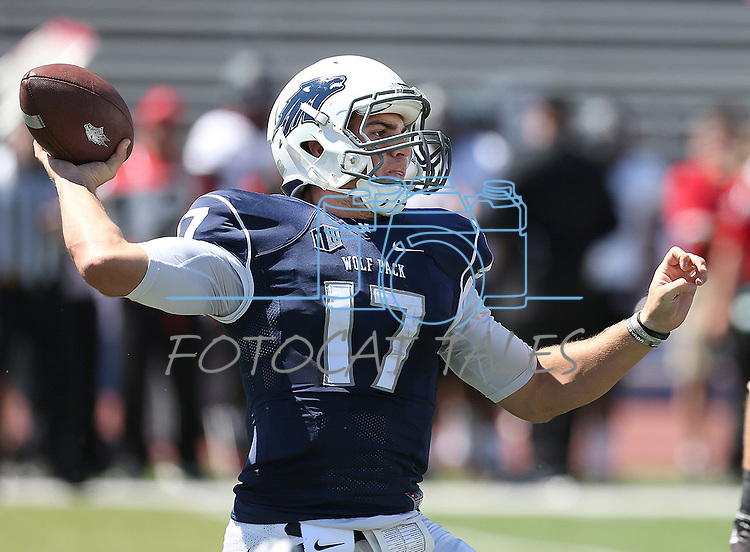Nevada's Cody Fajardo (17) looks to pass under pressure from Southern Utah's Josh Talbot (57) during the first half of an NCAA college football game on Saturday, Aug. 30, 2014, in Reno, Nev.<br /> (AP Photo/Cathleen Allison)