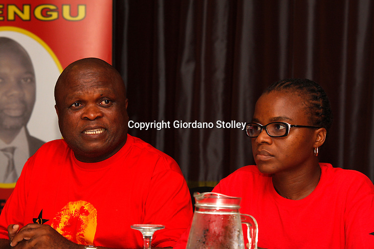 DURBAN - 2 February 2014 - The SA Communist Party's KwaZulu-Natal provincial secretary general Themba Mthembu (left) speaks at a press conference where the party  launches its provincial election campaign in support of the ruling African National Congress. Looking on is the party's provincial deputy chairwoman Nomarashiya Caluza. Picture: Allied Picture Press/APP