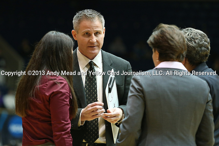 27 January 2013: Boston College head coach Erik Johnson talks to his staff during a timeout. The Duke University Blue Devils played the Boston College Eagles at Cameron Indoor Stadium in Durham, North Carolina in an NCAA Division I Women's Basketball game. Duke won the game 80-56.