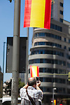 Tourist taking a photo of Madrid streets decoration with spanish flags the day before Felipe VI coronation as Spain´s King in Madrid, Spain. June 17, 2013. (ALTERPHOTOS/Victor Blanco)