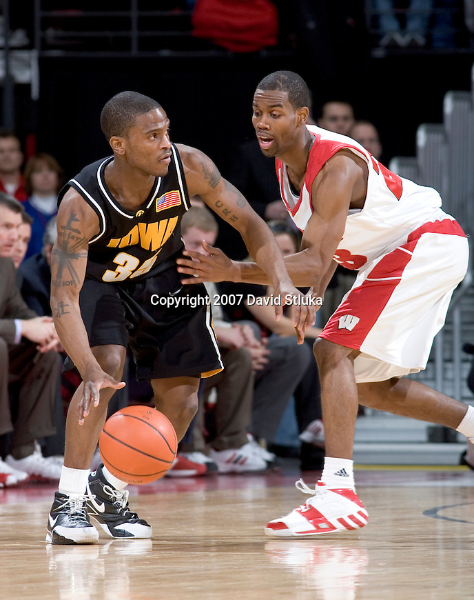 MADISON, WI - FEBRUARY 10: Guard Kammron Taylor #23 of the Wisconsin Badgers defends against guard Mike Henderson #35 of the Iowa Hawkeyes during their Big Ten Conference game at the Kohl Center on February 10, 2007 in Madison, Wisconsin. The Badgers beat the Hawkeyes 74-62. (Photo by David Stluka)