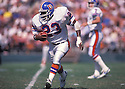 Denver Broncos Sammy Winder (23) in action during a game. Sammy Winder player for the Dallas Cowboys from 1982-1990.