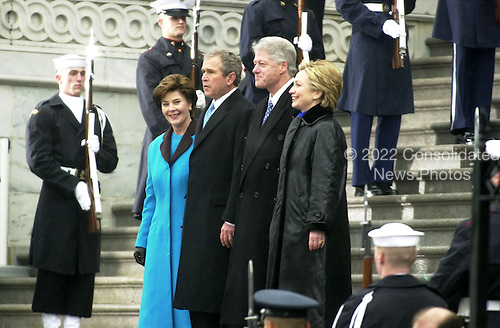 Washington, DC - January 20, 2001-- Former United States President Bill Clinton with his wife, Senator Hillary Rodham Clinton (Democrat of New York), and 43rd President George W. Bush and wife Laura decend the United States Capitol steps after the swearing-in ceremony for George W. Bush. .Credit: Ron Sachs / CNP