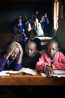 Students wait for their teacher at a primary school in Githunguri, outside Nairobi, Kenya.