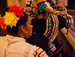 A dancer of the Latino Unidos Folklorico adjusts here hair while sitting in the balcony seats during a performance in the California Theatre in Pittsburg, California for the annual Cesar Chavez celebration on Saturday, March 29, 2014.  Photo/Victoria Sheridan