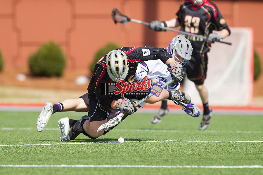 Mitch Wilson (26) of the VMI Keydets battles for a face-off against Jamie Piluso (25) of the High Point Panthers at Vert Track, Soccer & Lacrosse Stadium on March 8, 2014 in High Point, North Carolina.  The Panthers defeated the Keydets 9-8.   (Brian Westerholt/Sports On Film)