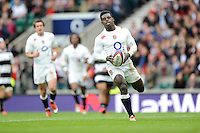 Christian Wade of England runs in his first try during the match between England and Barbarians at Twickenham Stadium on Sunday 31st May 2015 (Photo by Rob Munro)