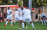 DJ Jumpin Jack Frost celebrates a goal with Taser Hassan during the 'Greatest Show on Turf' Celebrity Event - Once in a Blue Moon Events at the London Borough of Barking and Dagenham Stadium, London, England on 8 May 2016. Photo by Andy Rowland.