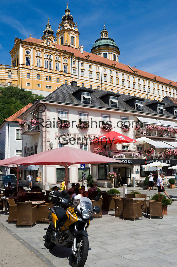 Austria, Lower Austria, Wachau, Melk: Old Town with Hotel Stadt Melk at Main Square surmounted by Benedictine Monastery Melk
