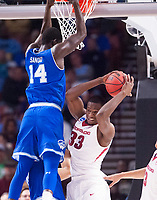 NWA Democrat-Gazette/J.T. WAMPLER Arkansas' Moses Kingsley brings down a rebound in front of Seton Hall's Ismael Sanogo Friday Mar. 17, 2017 during the first round of the NCAA Tournament at the Bon Secours Wellness Arena in Greenville, South Carolina. Arkansas won 77-71 and will advance to the second round, playing Sunday at the same location.