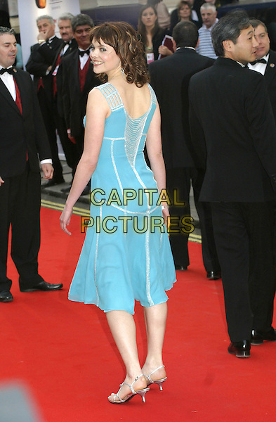 KATE FORD.Arrivals at the Pioneer British Academy Television Awards (TV BAFTA's), Theatre Royal, Drury Lane, .London, April 17th 2005..full length blue dress silver stripes strappy shoes.Ref: AH.www.capitalpictures.com.sales@capitalpictures.com.©Adam Houghton/Capital Pictures.