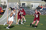 Los Angeles, CA 02/08/13 - Courtney McGrath  (Umass #9), Rachel Vallarelli  (Umass #26) and Kara Mupo  (Northwestern #8) in action during the Northwestern vs UMass NCAA Women's Lacrosse game at USC's McAlister Field.
