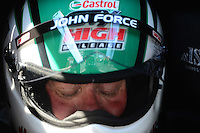 Apr. 13, 2012; Concord, NC, USA: NHRA funny car driver John Force rests in his car during qualifying for the Four Wide Nationals at zMax Dragway. Mandatory Credit: Mark J. Rebilas-