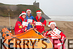 Tara Moran, Jason O'Dorothy, Emmet Lynch, Frank O'Connor, launching the Christmas Day Plunge in aid of the Ballybunion Sea and Cliff Rescue Service at 12.30 sharp, starting from the rescue center on Ladies Beach