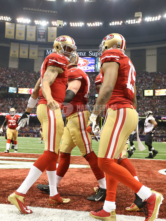 Feb 3, 2013; New Orleans, LA, USA; San Francisco 49ers quarterback Colin Kaepernick (7) celebrates with teammates after scoring a touchdown against the Baltimore Ravens in the fourth quarter in Super Bowl XLVII at the Mercedes-Benz Superdome. Mandatory Credit: Mark J. Rebilas-