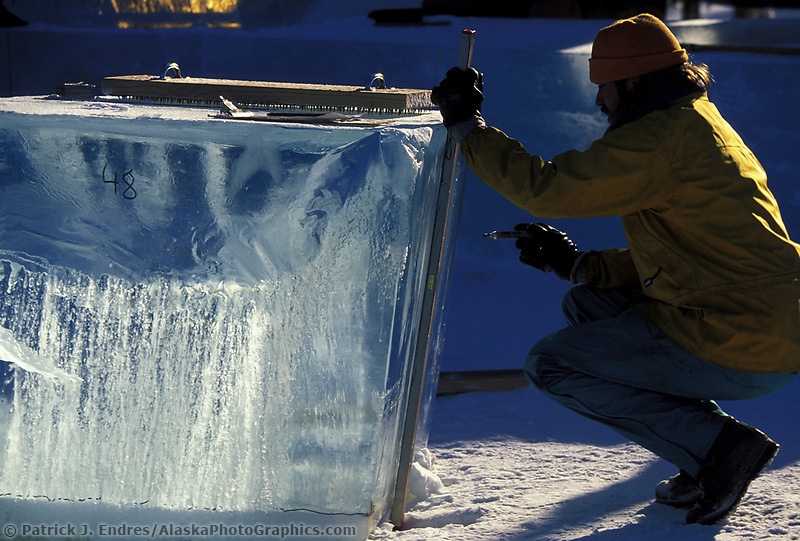 Ice sculptor marks ice block for cutting, during the World Ice Art Championships held each march in Fairbanks, Alaska,