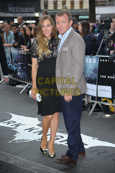 Jacqui Ainsley; Guy Ritchie.'The Dark Knight Rises' European premiere at Odeon Leicester Square cinema, London, England..18th July 2012.full length black dress pattern beige suit jacket shirt blue trousers pregnant white clutch bag .CAP/CAS.©Bob Cass/Capital Pictures.
