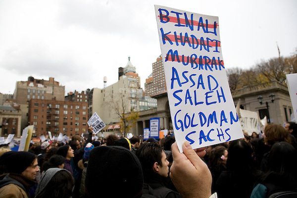 """Students, workers, and other supporters gather in Union Square Park to demonstrate continued solidarity with the Occupy Wall Street movement on its two month anniversary, which the movement has dubbed its """"Day of Action"""" in New York City, New York on 17 November 2011."""