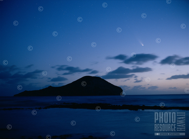 Comet Hale-Bopp seen over Rabbit Island (Manana Island) in morning twilight, Oahu, Hawaii.