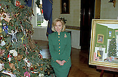 First lady Hillary Rodham Clinton guides members of the press through the White House Christmas decorations in Washington, DC on December 2, 1996.  Here the first lady is photographed with the White House Christmas Tree and a rendering of their Christmas card in the Blue Room.<br /> Credit: Ron Sachs / CNP