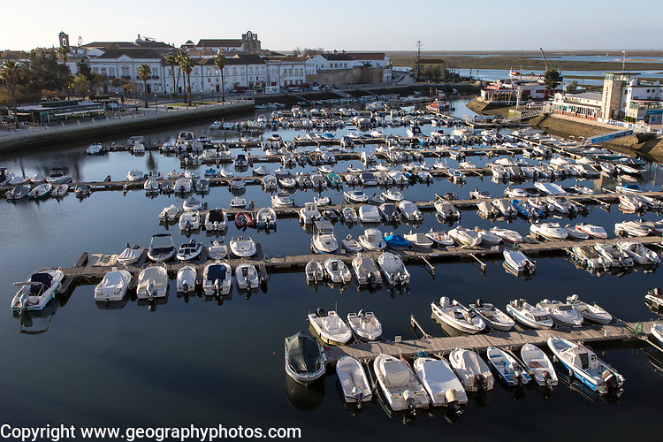 Boats at moorings early morning in the marina at the harbour at Faro, Algarve, Portugal
