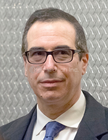 United States President-elect Donald Trump's nominee for Secretary of the Treasury Steven Mnuchin is seen waiting for an elevator lobby Trump Tower in New York, NY, USA on December 6, 2016. <br /> Credit: Albin Lohr-Jones / Pool via CNP /MediaPunch