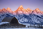 The high peaks of the Tetons tower behind the Moulton Barn in Grand Teton National Park, Jackson Hole, Wyoming.