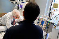 "Dr. Allan Ropper examines a patient as residents and fellows look on while on rounds to perform neurological examinations of patients at the Neuroscience Intensive Care Unit at Brigham and Women's Hospital in Boston, Massachusetts, on Wed., Sept. 24, 2014. Ropper is the Executive Vice Chair of Neurology at Brigham and a professor at Harvard Medical School specializing in neurology. On September 30, Ropper's recent book ""Reaching Down the Rabbit Hole: A Renowned Neurologist Explains the Mystery and Drama of Brain Disease"" will be published by St. Martin's Press."
