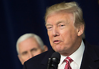 United States President Donald J. Trump makes remarks to the media at Camp David, the presidential retreat near Thurmont, Maryland after holding meetings with staff, members of his Cabinet and Republican members of Congress to discuss the Republican legislative agenda for 2018 on January 6, 2018.   Looking on is US Vice President Mike Pence.<br /> CAP/MPI/RS<br /> &copy;RS/MPI/Capital Pictures