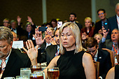 Audience members pray before United States President Donald J. Trump delivers remarks at Values Voter Summit at the Omni Shoreham Hotel on October 12, 2019 in Washington, DC. The appearance at the Summit comes as evangelical leaders this week criticized Trump's decision to stand down US forces in northern Syria. <br /> Credit: Pete Marovich / Pool via CNP